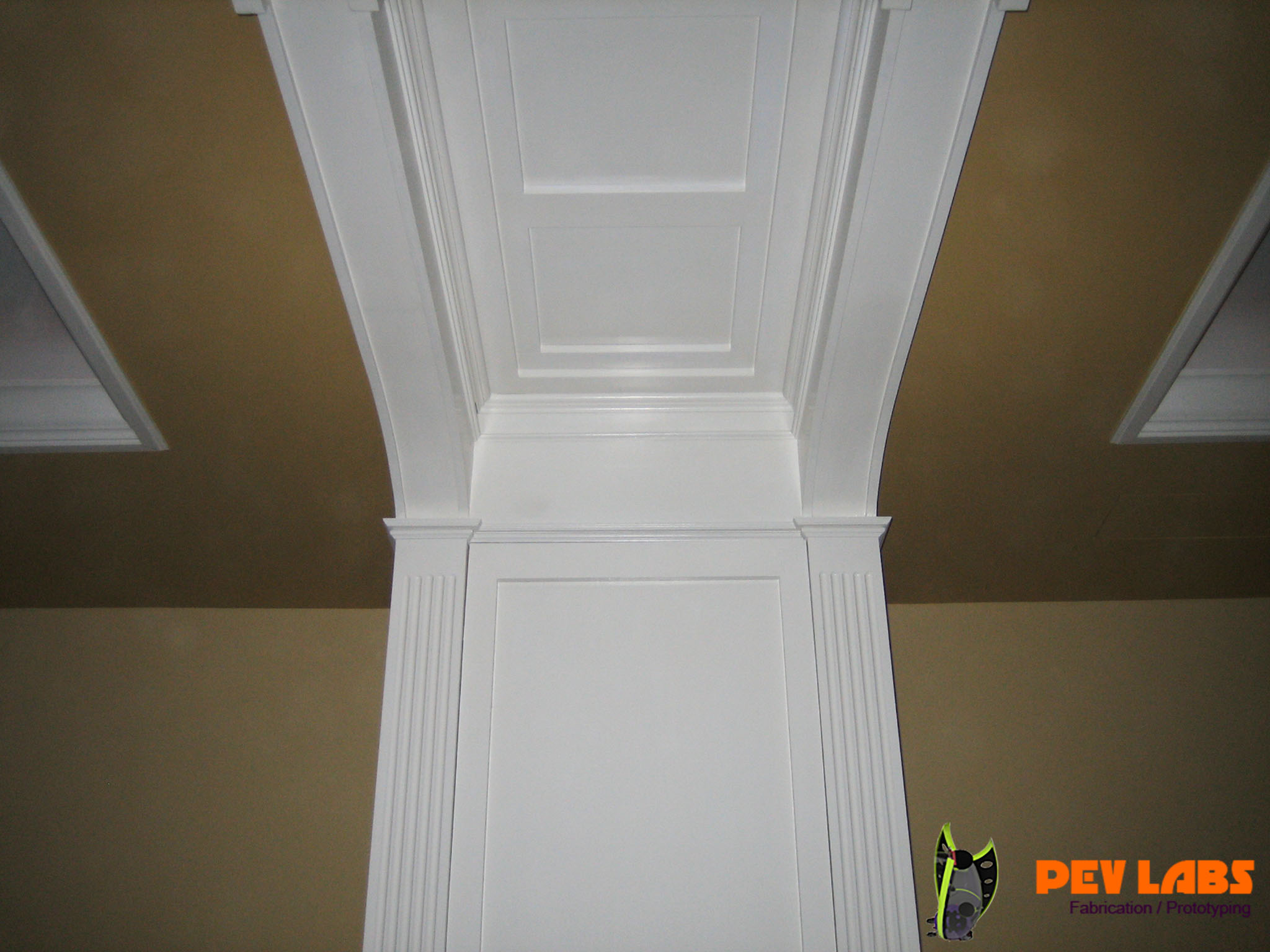 Hidden Cabinetry in Archway Panels and Ceiling Panel